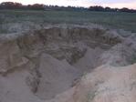 Мини-город в песке... Вроде как гнёзда ласточек...